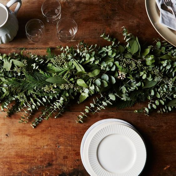 Greenery garland for centerpieces - Foraged and wholesale greenery to fill the center of each table.