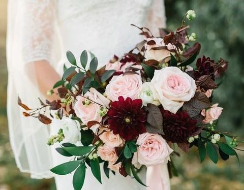 Bride's bouquet - Combination of blush and burgundy tones. Mixture of fall foliage and filler flower.