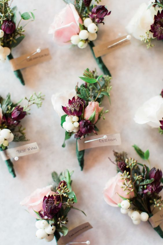 Bouttonnieres  - Groom and groomsmen will have burgundy, filler and greenery. We tie boutonnieres with stems exposed.