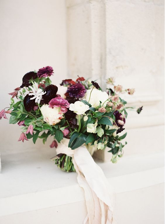 Bride's Bouquet - A lush variety of roses and filler flower. Hints of burgundy and blush tones.
