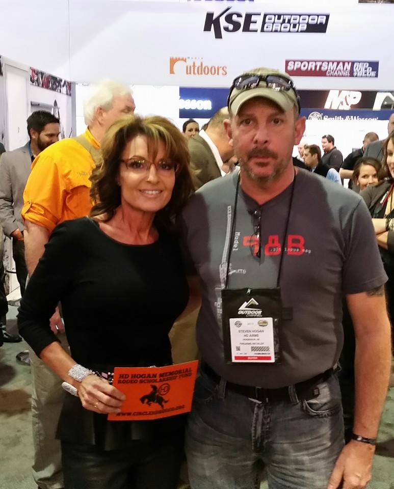 Sarah Palin displaying the HD logo with Steve.