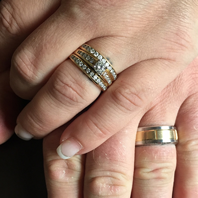 Chantal used the stone from her first engagement ring and put it in a new set with two new anniversary bands boasting 34 beautiful diamonds that included her original stone.