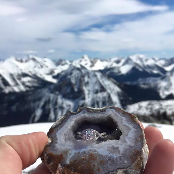 Rockin' in the rockies:  Brittney's engagement ring nestled inside a crystal coated rock hollow with the majestic rocky mountains in the background.