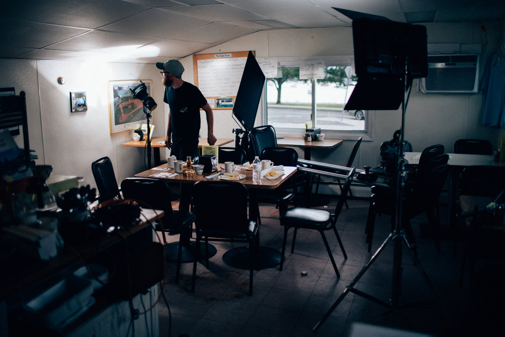 """Brandon setting up our lighting for """"Zone 2"""" of the diner scene. The Kessler Shuttle Dolly fits perfectly into these tight locations."""