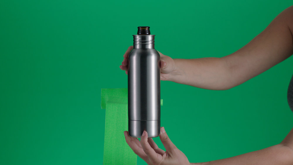 The BottleKeeper being placed on the bottle - green gaff card covered our grip equipment.