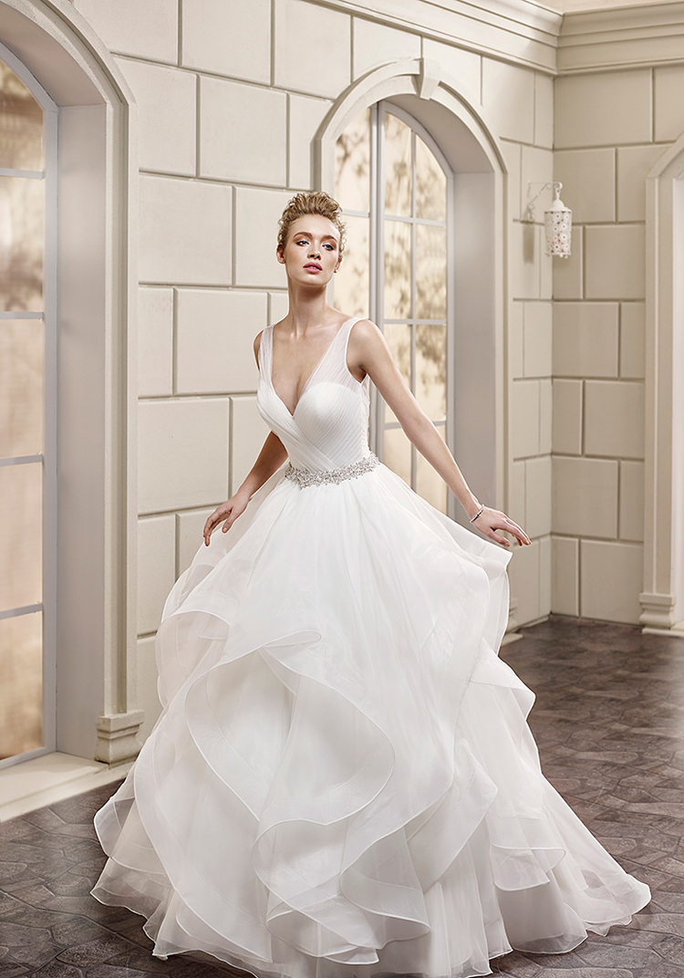 From Eddy K.'s Milano Collection, style AK150 is a sexy, yet classically styled ball gown wedding dress whose plunging neckline, though front and centered, is not the only star of the show!