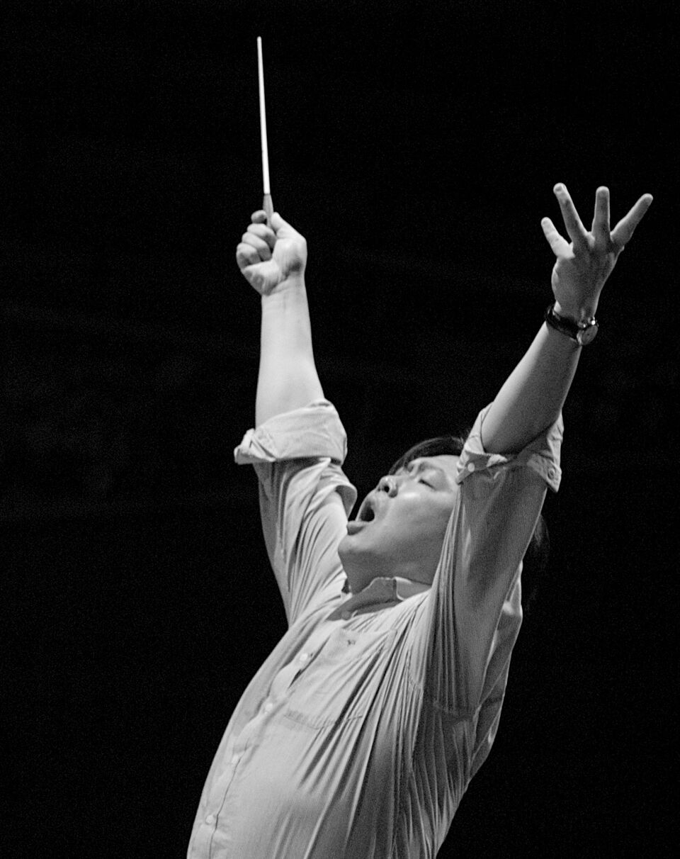 Long Yu passionately conducting