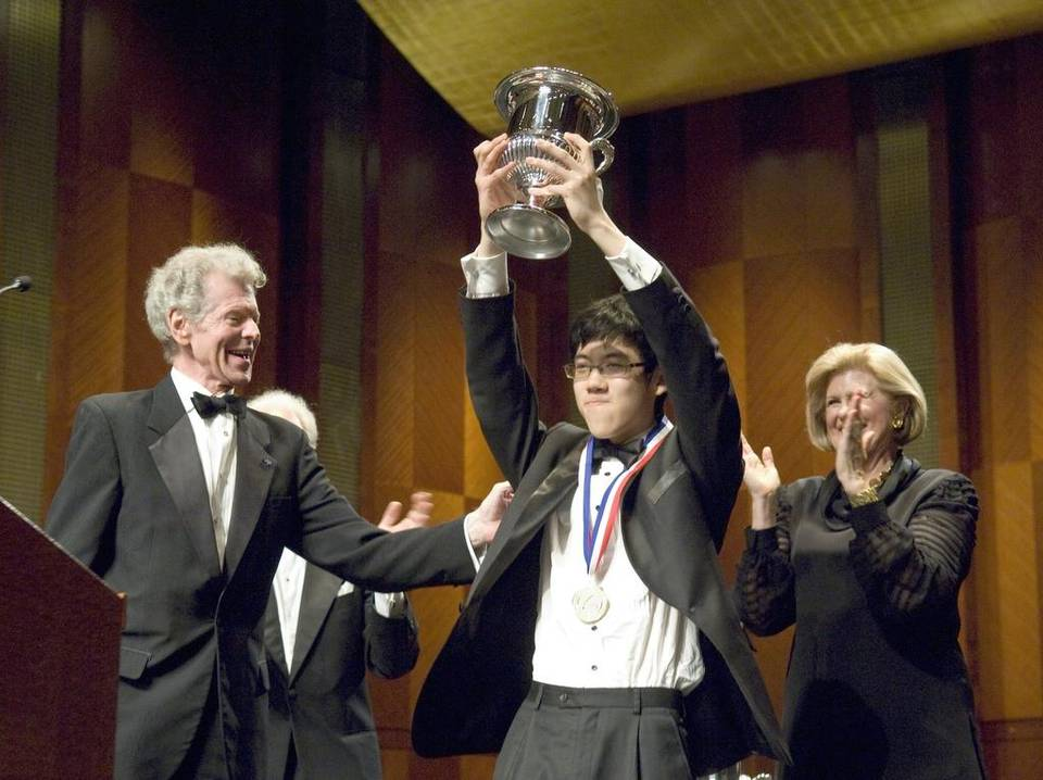 Van Cliburn, left, joins Haochen Zhang's victory celebration in this 2009 photo. Credit:  Anonymous, AP archives