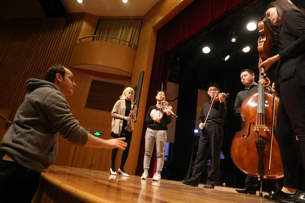 "Cellist Mike Block coaches a chamber group before a YMCG ""Tomorrow Concert."" Photo by Liang Yan"