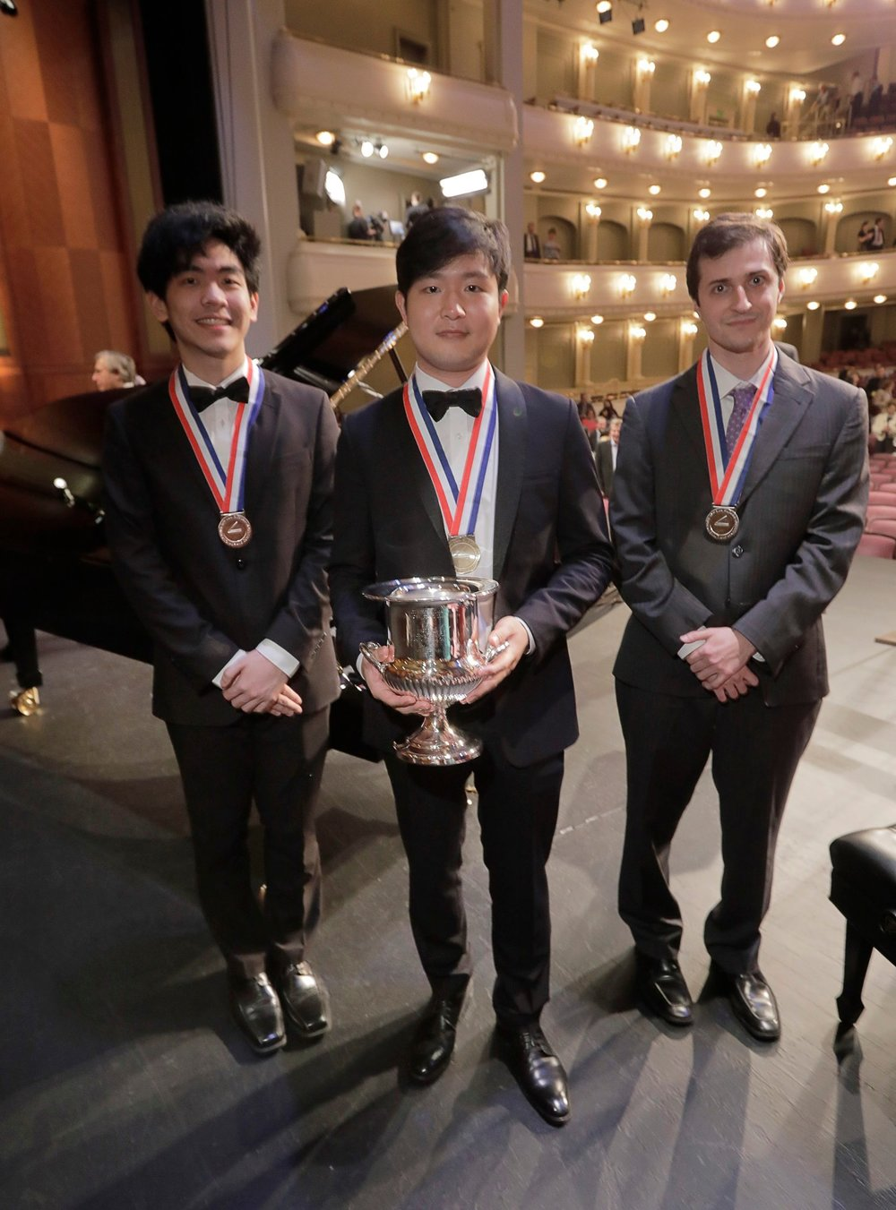 The Cliburn winner, Yekwon Sunwoo, center, with the bronze medalist Daniel Hsu, left, of San Francisco, and the silver medalist Kenneth Broberg, right, of Minneapolis. Credit Ralph Lauer