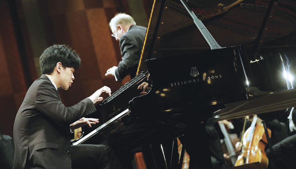 June 3, 2017. Daniel Hsu of the United States performs with conductor Nicholas McGegan and the Fort Worth Symphony Orchestra Saturday during his concerto in the Semifinal round at The Fifteenth Van Cliburn International Piano Competition held at Bass Performance Hall in Fort Worth, Texas. (Photo Ralph Lauer)