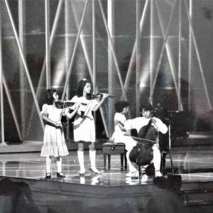 Anne Akiko Meyers as a child and onstage at the Emmy Awards Show
