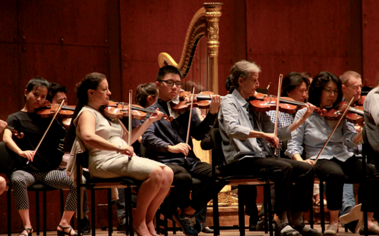 Yu Renchao (third from left), from Shanghai, at a rehearsal with the New York Philharmonic on Monday at Lincoln Center. [Photo by Hong Xiao/CHINA DAILY]