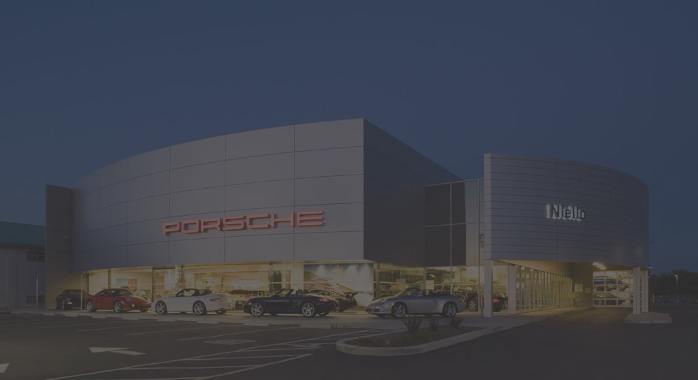 For a new Porsche dealership in Rocklin, California, murakami/Nelson was tasked with creating a building that reflected the brand values of Porsche – high performance and design superiority. The 26,700 s.f. facility uses clean lines and modern materials to draw the public's attention from the road. The curved 28-foot tall show room wall is clad in aluminum composite panels with a contrasting band of clear glazing below. The service component of the dealership is marked by a contemporary service canopy that leads to the customer write-up area. The service garage itself contains 17 working bays along with two wash/detail bays.
