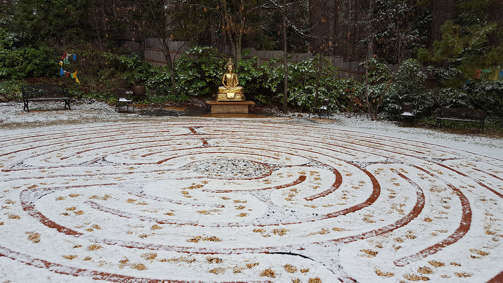 Snow on the labyrinth. Buddha is in place and just needs a temple.