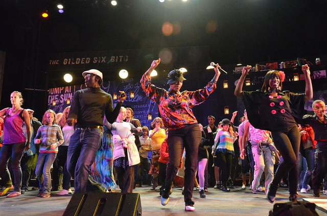 Audience members dance on stage, led by Traci Bartlow, after a performance of  Spunk  at Cal Shakes