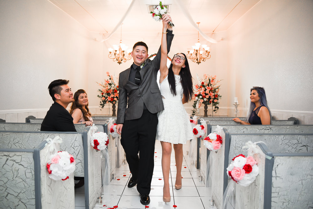 A Newly wedded bride and groom walk as one for the first time in The Grand Chapel at A Wedding Chapel in Las Vegas. © 2017 All Rights Reserved, Destination Las Vegas Group