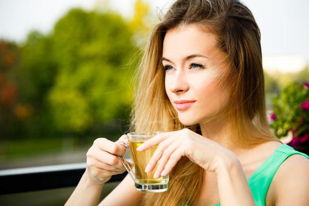 woman-outside-drinking-green-herbal-tea.jpg
