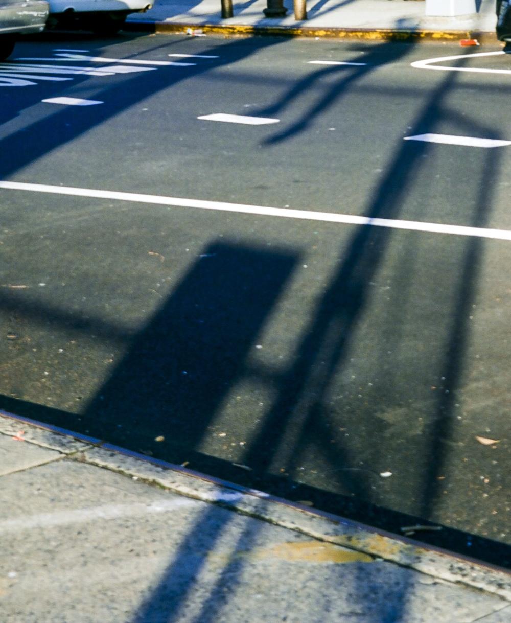 Nick Fence Climb Shadow copy.jpg