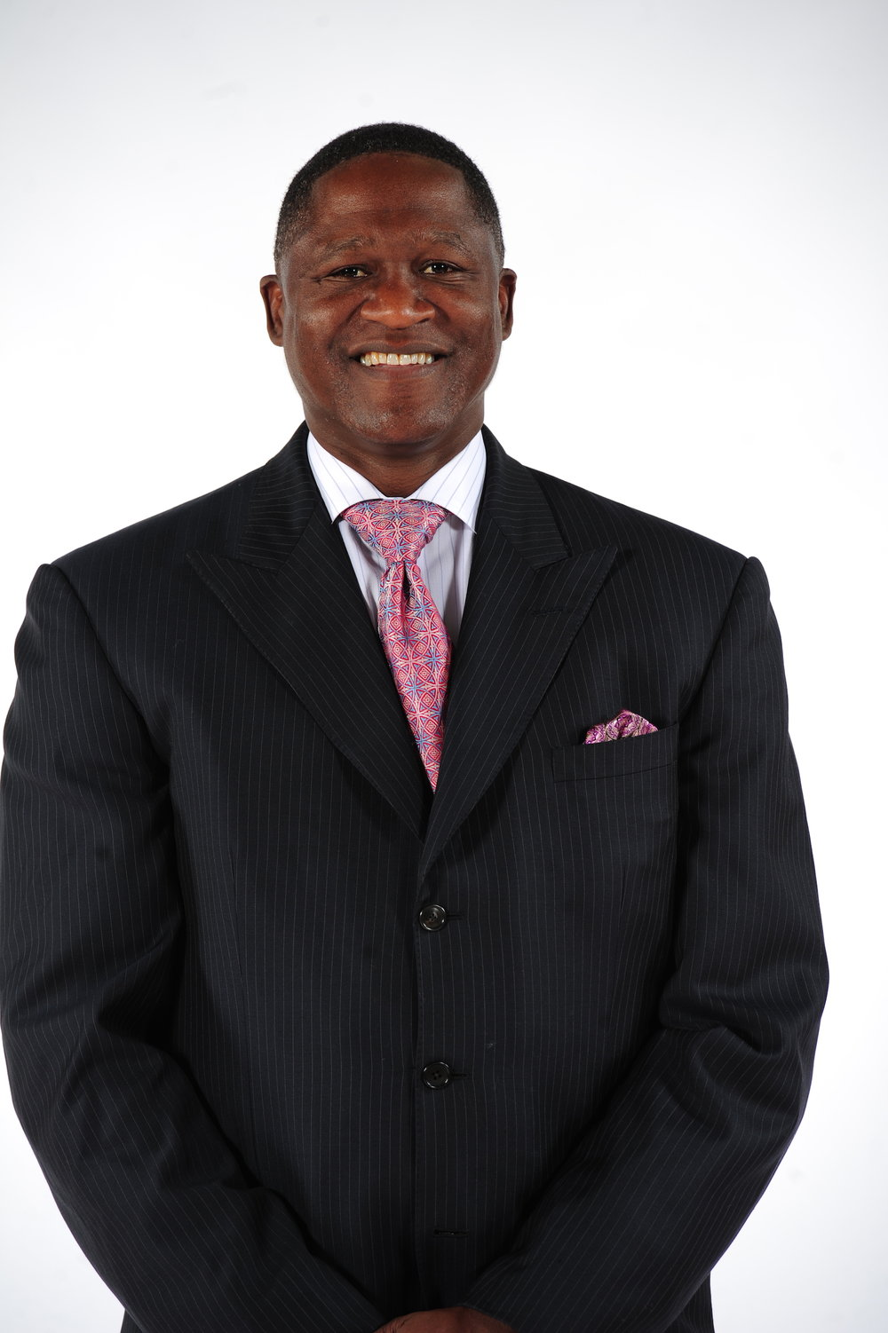 "The most celebrated player to ever put on a Hawks uniform and represented in front of Philips Arena by an 18,500-pound bronze statue erected in March, 2015, Hall-of-Famer Dominique Wilkins is the Hawks' Vice President of Basketball and Special Advisor to the CEO. Wilkins works in various management functions within the organization's basketball and business areas, and as the team's analyst for the Hawks broadcasts on FOX Sports Southeast. Wilkins is responsible for advising the senior management team on basketball-related issues and working as a strong voice in the community. The 6-8 forward, who concluded his NBA career with 26,668 points, is the 13th all-time leading scorer in league history and his 24.8 career scoring average is tied for 13th on the all-time charts. Wilkins' 23,292 points with the Hawks are the franchise's best, and he ranks second in team history in steals (1,245), fourth in rebounds (6,119), seventh in blocked shots (588) and eighth in assists (2,321). One of league's true marquee players, his outstanding contributions on the court were recognized by the organization in January 2001 when he became the third player in club history to have his uniform number (#21) retired, joining Hawks legends Bob Pettit and Lou Hudson. Familiar to area sports fans from his collegiate days at the University of Georgia, Wilkins entered the 1982 NBA Draft after his junior season with the Bulldogs. He ended his Georgia career as the school's all-time scoring leader with averages of 21.6 points to go along with his 7.5 rebounds. A three-time All-SEC performer who also took home the Most Valuable Player award from the 1981 Southeastern Conference tournament, he was selected with the third overall pick in the first round by the Utah Jazz. Hawks officials valued his talents enough to send two players (John Drew and Freeman Williams) and cash to the Utah Jazz on September 2, 1982 for his draft rights, and the end result was beneficial for both parties. Wilkins was able to continue his career in front of familiar faces, and Atlanta had its first superstar since Pete Maravich. Instrumental in the team's success in the mid-to-late '80s, Wilkins electrified Atlanta sports fans as the club recorded 50-win seasons four straight times from 1985-86 to 1988-89. He averaged 29.1 points over that period, and in the 1988 All-Star Game he ripped the nets for 29 points in 30 minutes of action. Wilkins led the Hawks to the playoffs in eight of his 12 seasons with the Hawks, his finest hour came during the 1988 postseason when Atlanta narrowly missed reaching the Eastern Conference Finals, as the Boston Celtics eked out a two-point victory in Game 7 of the conference semifinals. Wilkins averaged 31.2 points in 12 playoff contests that year, and having participated in 10 years of playoff competition, scored 25.4 points per game. After missing only 18 of a possible 738 regular season games his first nine years, Wilkins suffered a season-ending tear of Achilles tendon midway through the 1991-92 season. Wilkins responded the next season by scoring 29.9 points per game to finish second to Michael Jordan for the league scoring title. He was a member of the NBA All-Rookie Team in 1983 and was named to seven All-NBA teams, nine consecutive all-star squads and was a two-time winner of the NBA Slam Dunk Championship (1985 and 1990). On November 6, 1992 against the New York Knicks, a patented baseline jumper led to Wilkins becoming the 17th person in league history to join the 20,000-point club, and later that season (February 2, 1993 against Seattle), he supplanted Pettit as the franchise's all-time leading scorer. His stellar career in Atlanta came to an end on February 24, 1994 when he was traded to the Los Angeles Clippers. At the conclusion of the year, Wilkins decided to test the free agent market and signed with the Boston Celtics. Wilkins joined Panathinaikos Athens of the Greek League the following season (1995-96). He was named MVP of the European Final Four after averaging 20.9 points and 7.0 rebounds and leading the team to the European Men's Championship. Seeking a return to the States, Wilkins signed a free agent contract with San Antonio and provided more than the Spurs possibly imagined, leading the Spurs in scoring with an 18.2 average and grabbing 6.4 rebounds. He returned overseas for the 1997-98 campaign, signing with Italy's Teamsystem before rejoining the NBA for his final professional season (1998-99), as Wilkins saw action in 27 games for the Orlando Magic. Extremely active with local and national charity endeavors, Wilkins has done work with the Juvenile Diabetes Research Foundation, Cystic Fibrosis Foundation, Special Olympics, Muscular Dystrophy Association and American Lung Association. In July 2007, Wilkins launched ""Nique and Newt's Full- Court Press on Diabetes"" with former Speaker of the United States House of Representatives, Newt Gingrich. In March 2010, Wilkins was honored by the Georgia State Legislature as they presented a State Resolution naming him the Diabetes Ambassador for the state of Georgia. He is also a diabetes ambassador for Novo Nordisk, a world leader in Diabetes care. Wilkins, 57, was born on January 12, 1960 in Paris, France. He joined basketball's immortals with his entry into the Naismith Memorial Basketball Hall of Fame on September 8, 2006, was inducted into the Georgia Sports Hall of Fame on April 3, 2004, the Atlanta Sports Hall of Fame's inaugural class on June 10, 2005 and the National Collegiate Basketball Hall of Fame on November 18, 2016. Wilkins was honored in October 2011 with his induction into the Boys & Girls Clubs of America Alumni Hall of Fame."