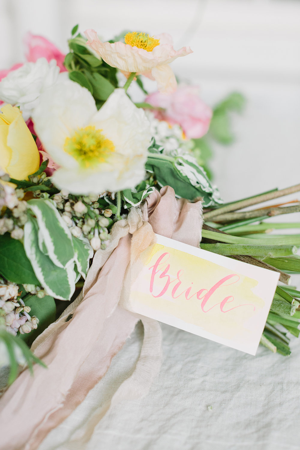 Watercolor place card details with pink calligraphy