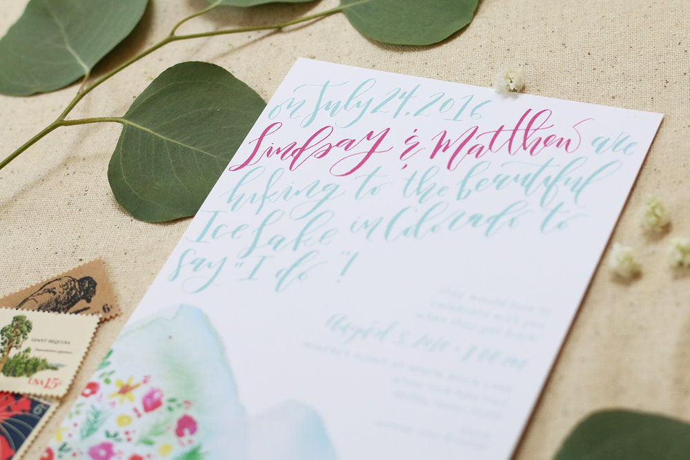 Custom calligraphy on this watercolor wedding invitation for a Colorado elopement!
