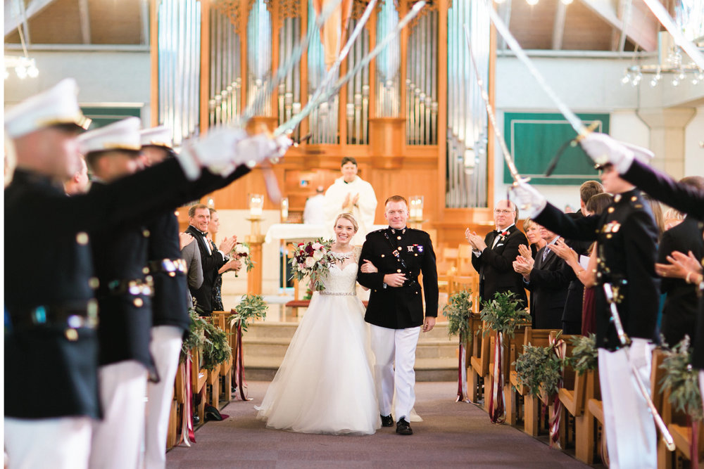 Marine Corps wedding tradition, the bride and groom exiting under a sword arch!