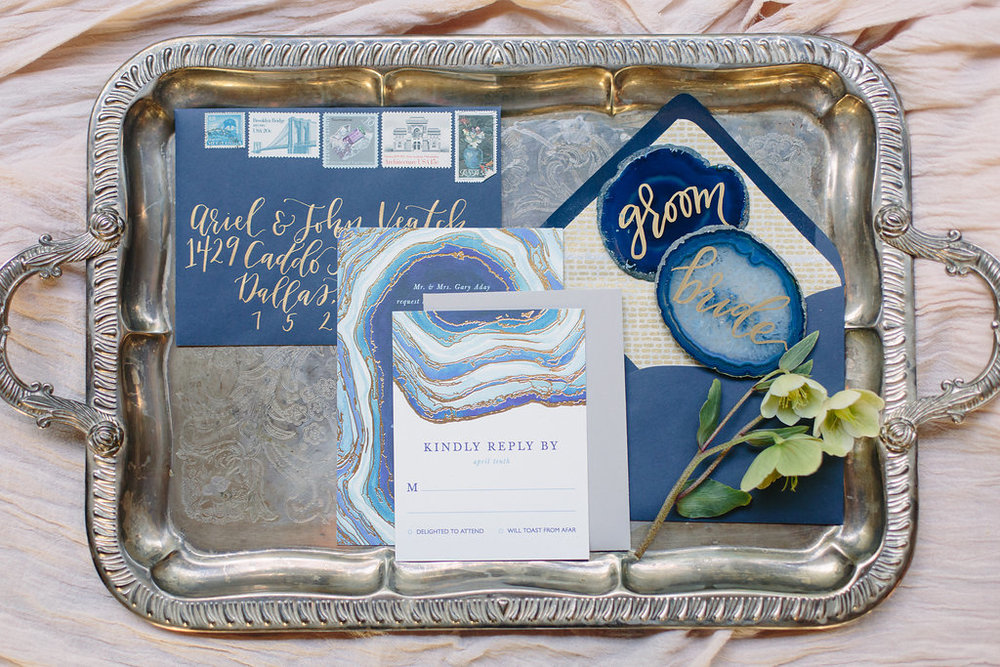 These wedding invitations are by Minted, and Goldie Design Co. designed a custom styled envelope set to match. Also featured are agate stone place cards with gold lettering.