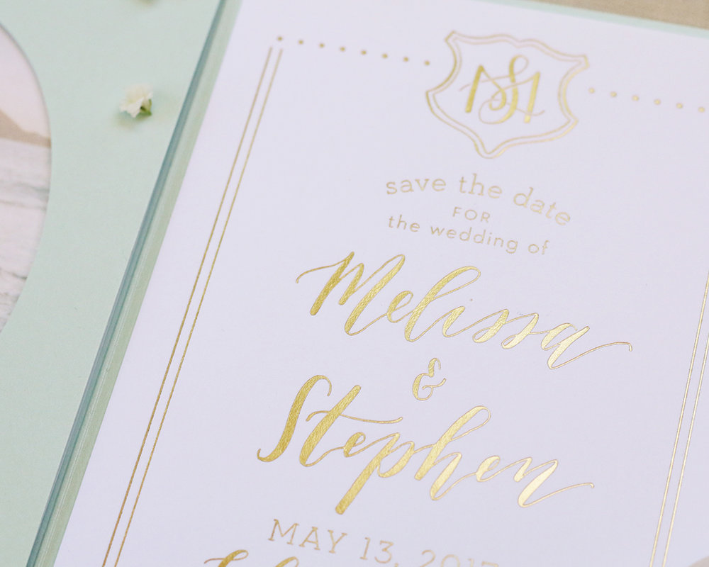 Gold foil save the date calligraphy design for a summer destination wedding in Cabo.