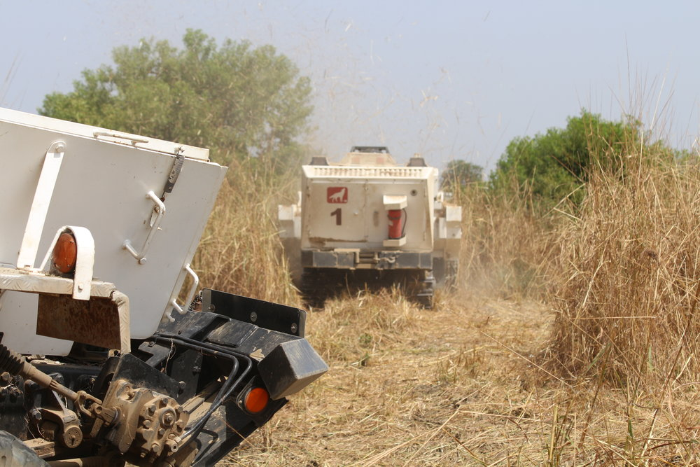 GCS vehicle with tiller attachment during mine clearing operations in dry and hard terrain with medium vegetation density in Sudan