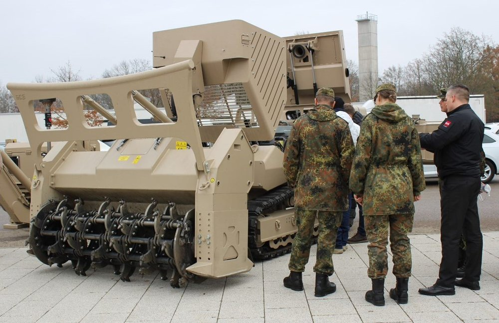 Representatives of the German Armed Forces viewing the GCS-200 in the Mine Clearance configuration with our unique tiller attachment T-200.