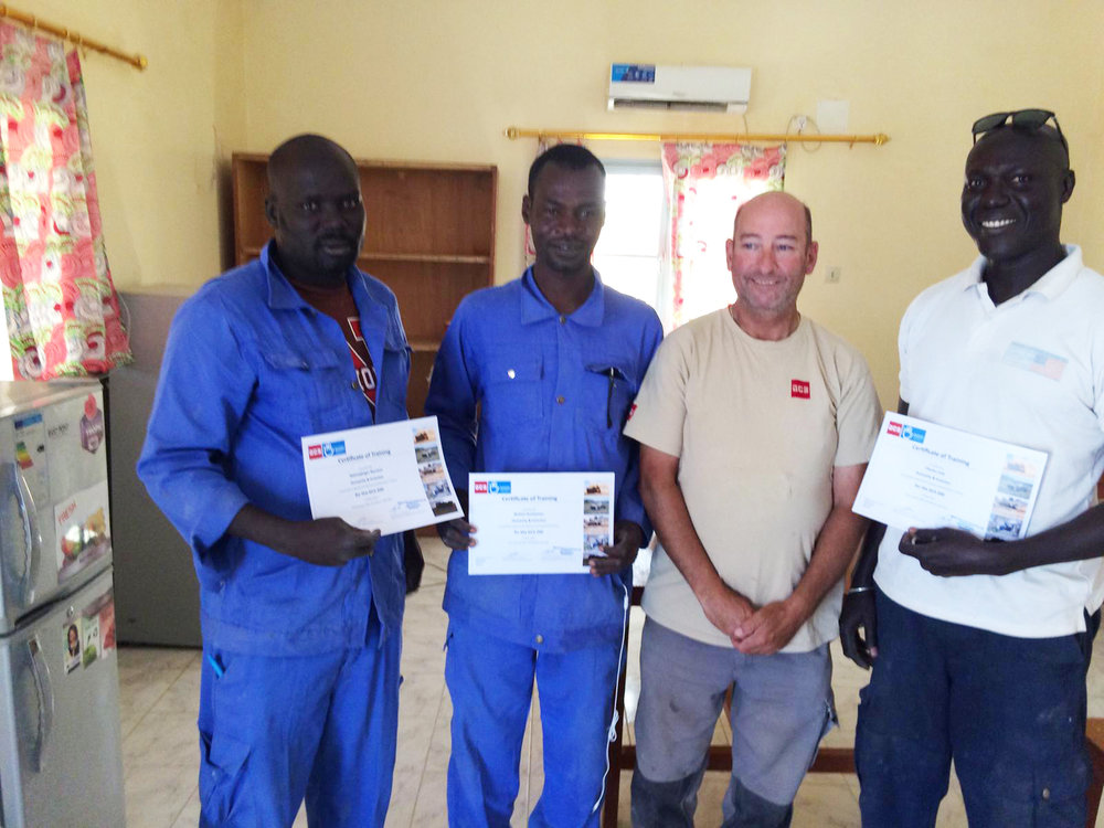 Three local HI operators are presented with their Certificates of Training by GCS' Global Technician