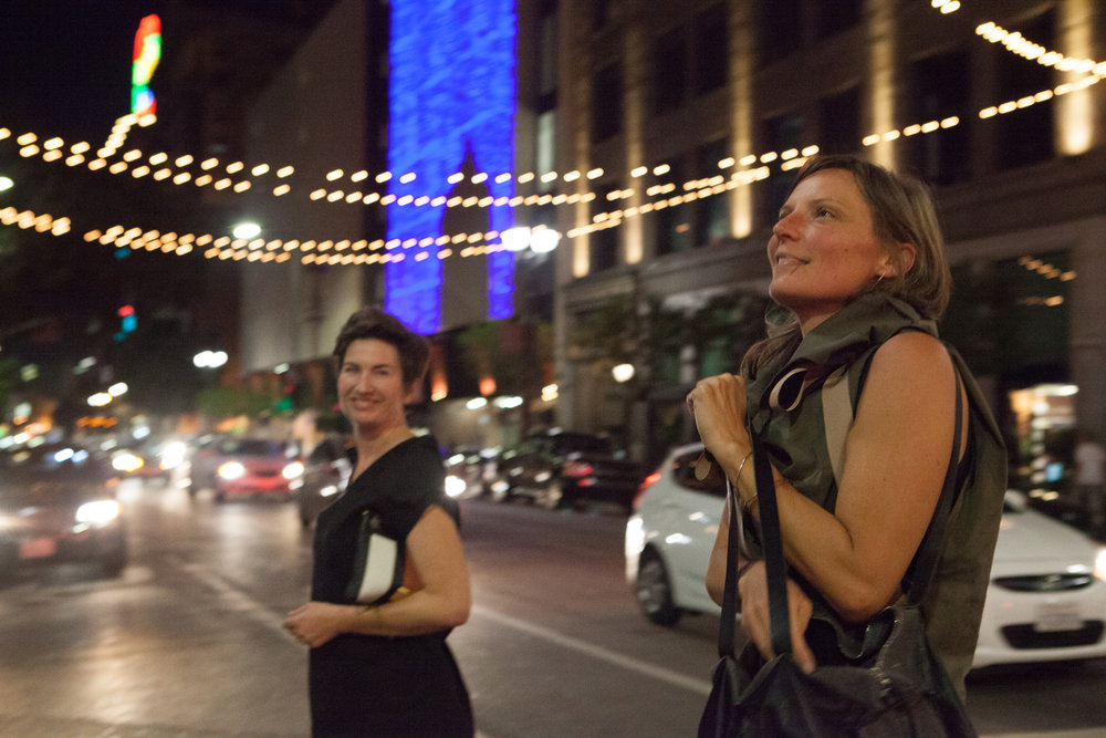 Black V-neck shirt and muted green shirt with grosgrain ribbons worn by Emily and her friend on a night out in downtown Los Angeles.