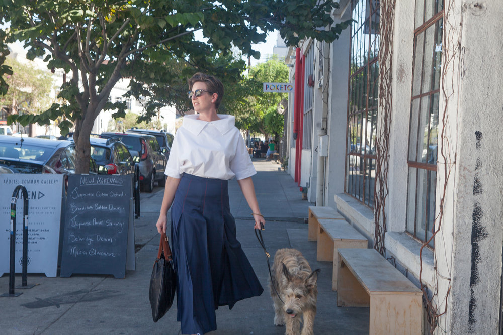 Emily walking her dog in the Arts District of Los Angeles wearing her White Collar Shirt.