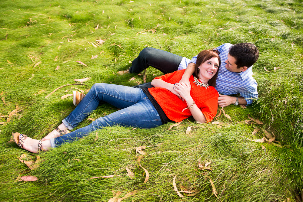 Couple laying together in grass