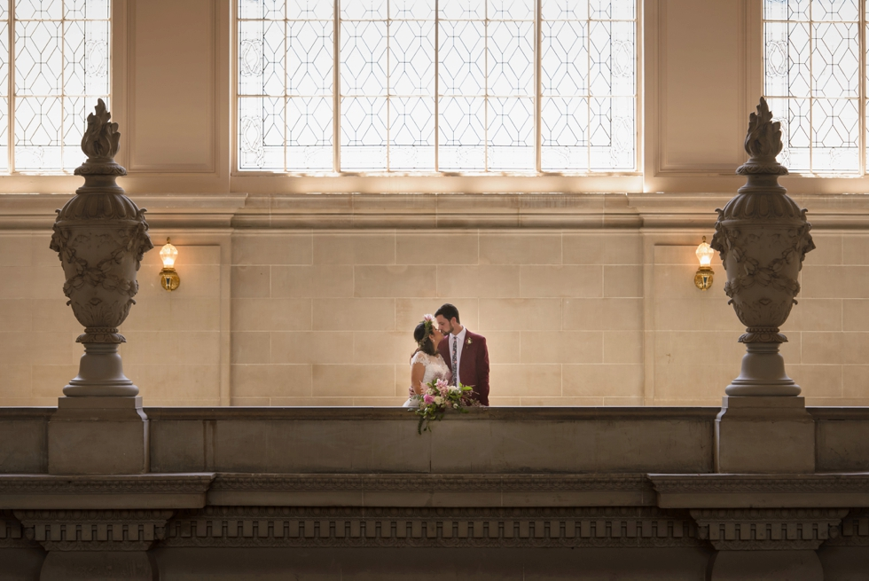 Bride and groom kissing at SF City Hall