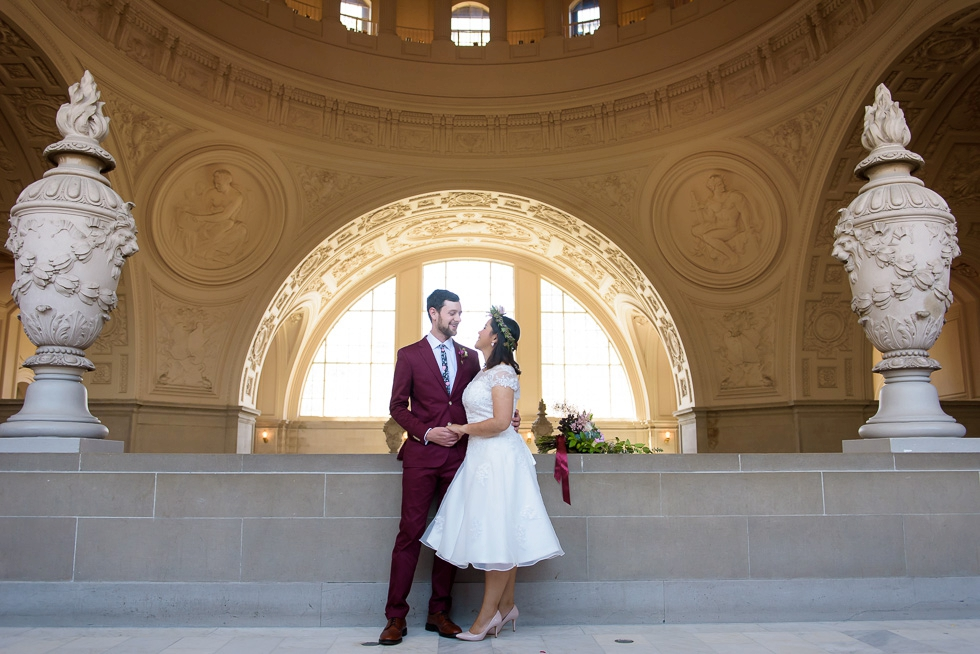 Bride and groom at City Hall with flowers