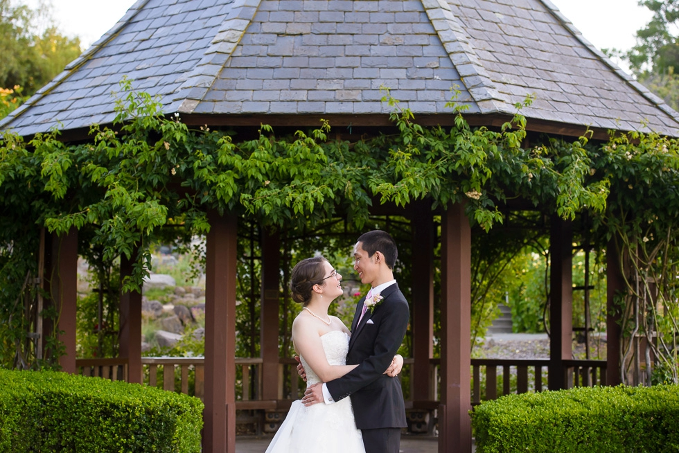 Bride and groom under gazebo