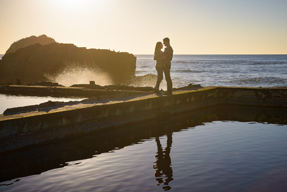 Couple hugging at Sutro Baths at sunset