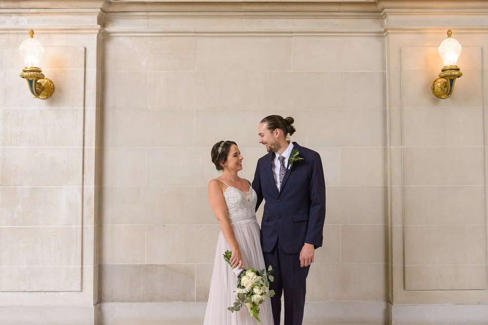 Couple smiling at San Francisco City Hall wedding