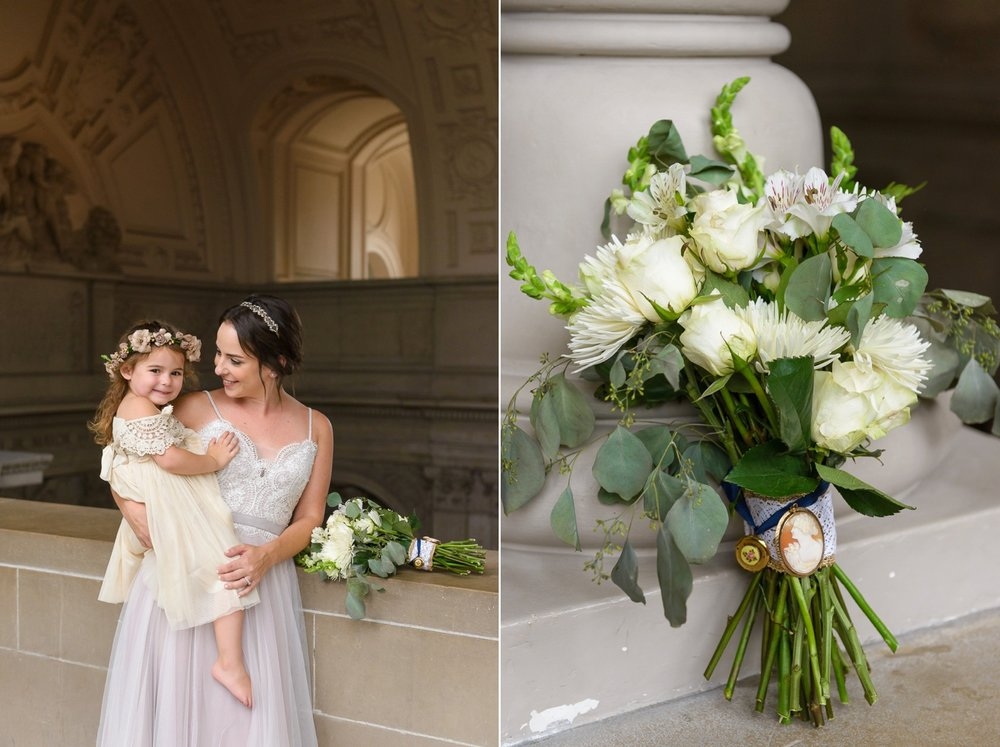 Bride and flower girl with flowers at San Francisco City Hall