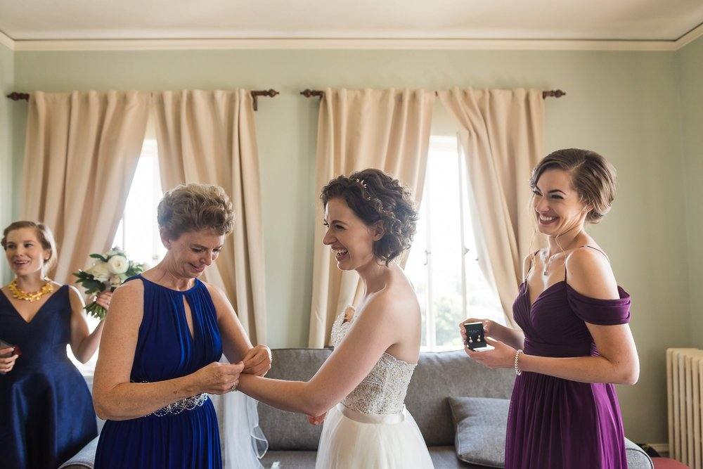 A bride getting ready with her mother and sister