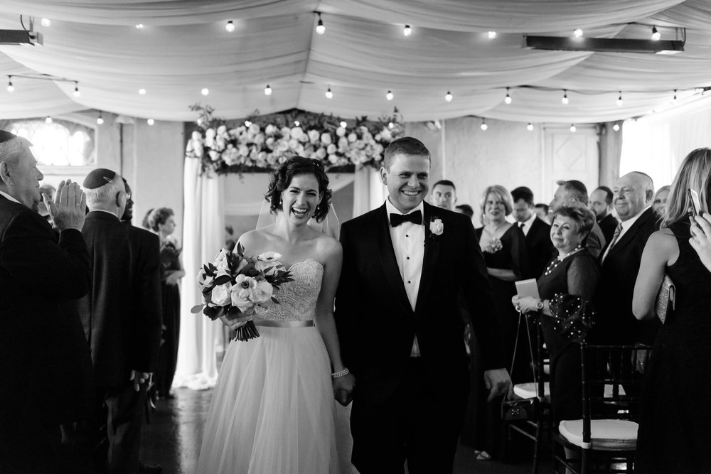 Bride and groom smiling after wedding ceremony