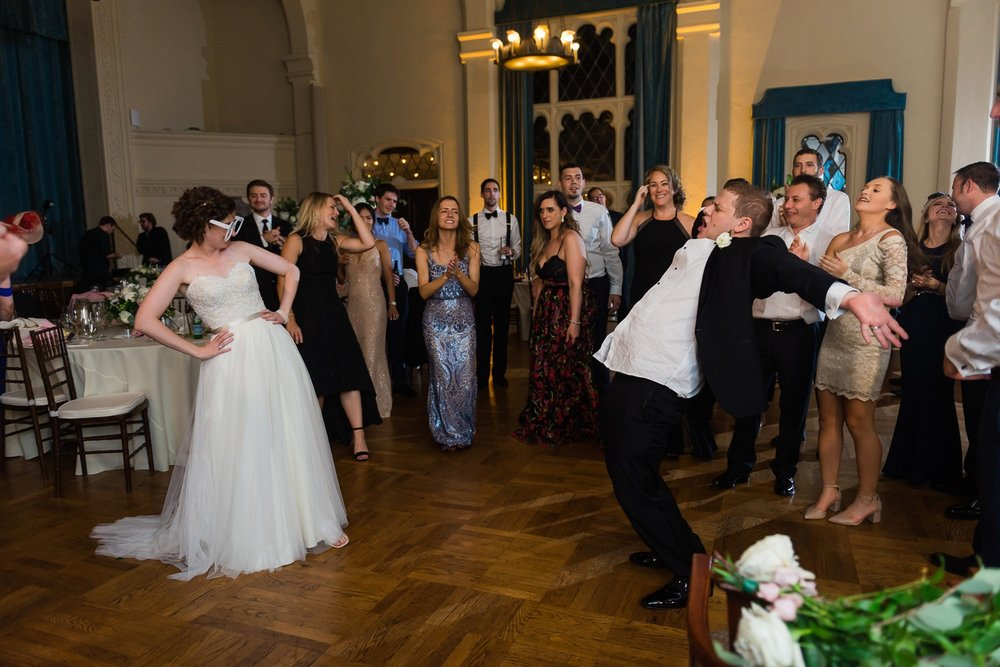 Bride and groom dancing silly