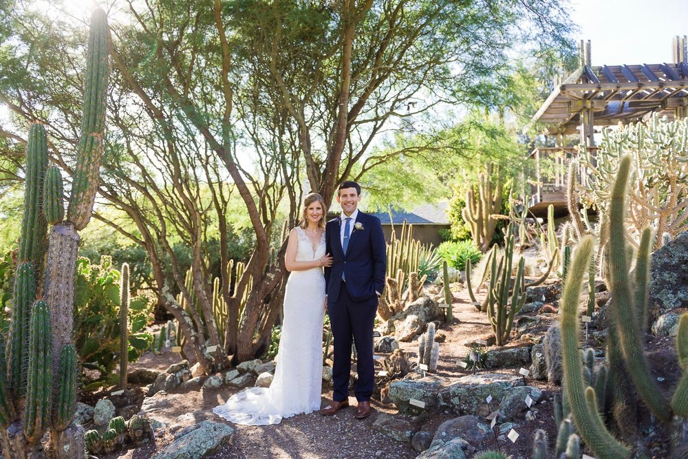 Bride and groom in a cactus and succulent garden