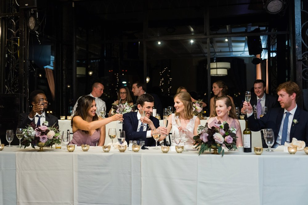 Wedding couple and wedding part toasting champagne