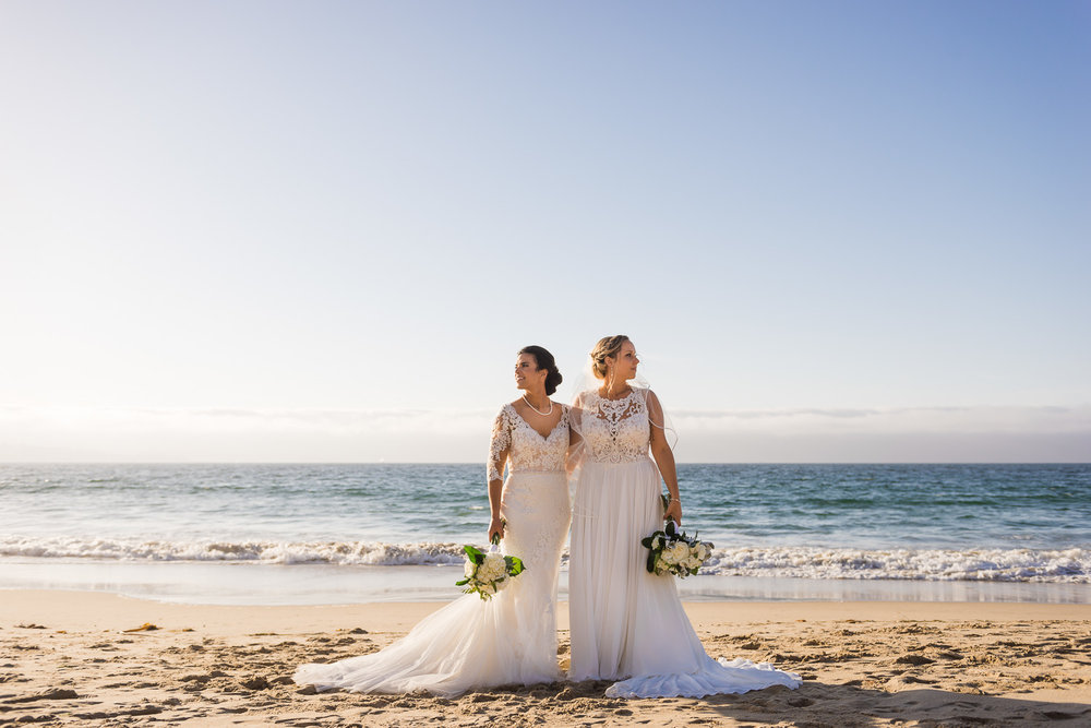 Two brides on the beach in Monterey