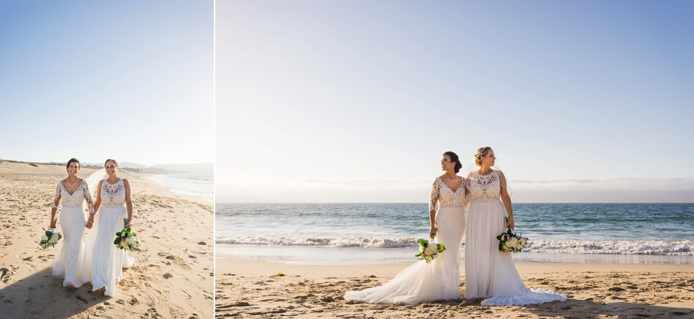 Two brides posing for portraits on the beach