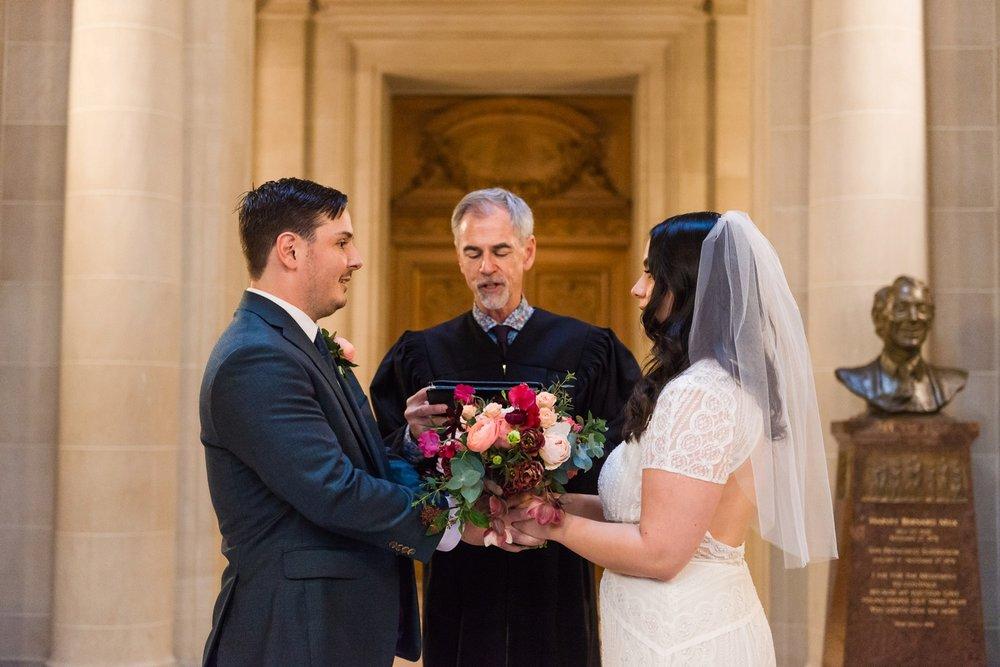 Bride and groom at San Francisco City Hall rotunda