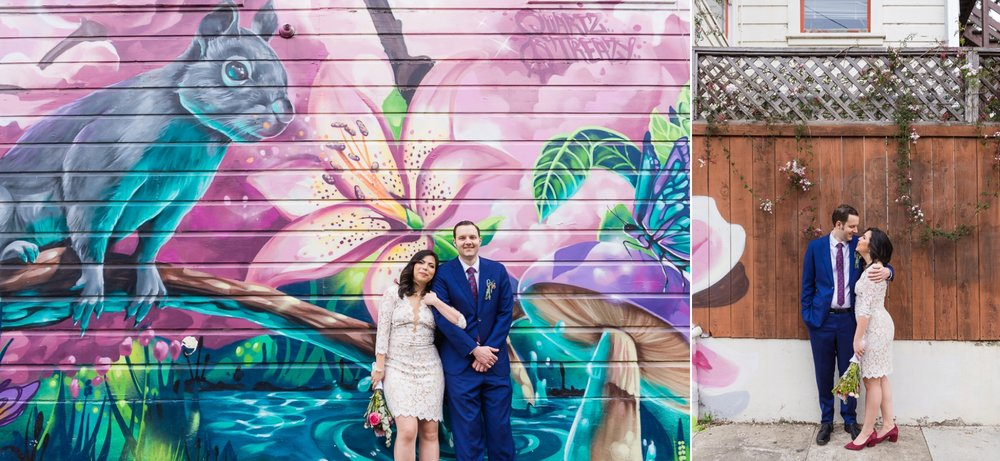 Bride and groom in front of a mural